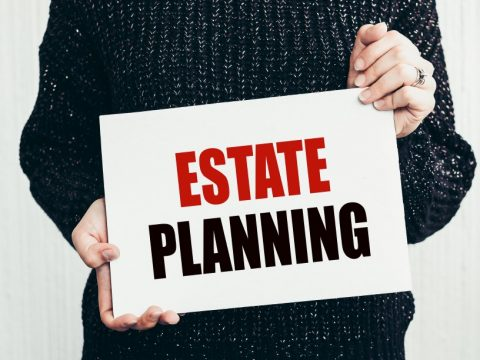 a Man holding an Estate Planning sign