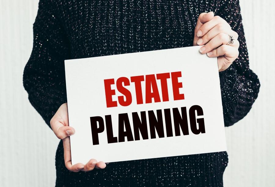a Man holding an Estate Planning sign