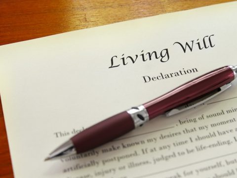 A pen laying on top of a living will document