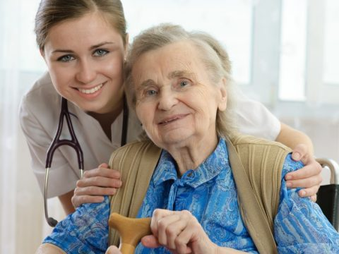 A nursing home resident with a nurse
