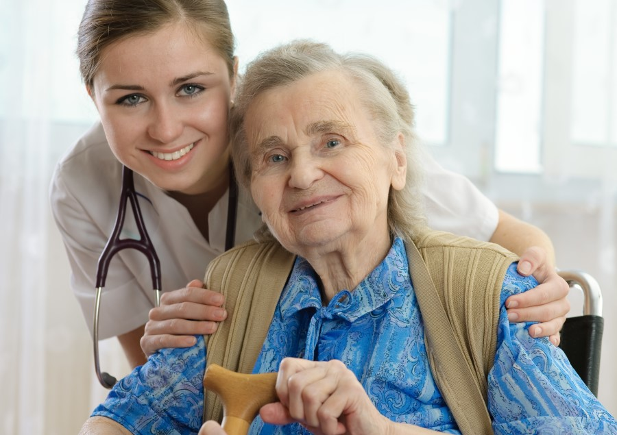 A nursing home resident with a nurse