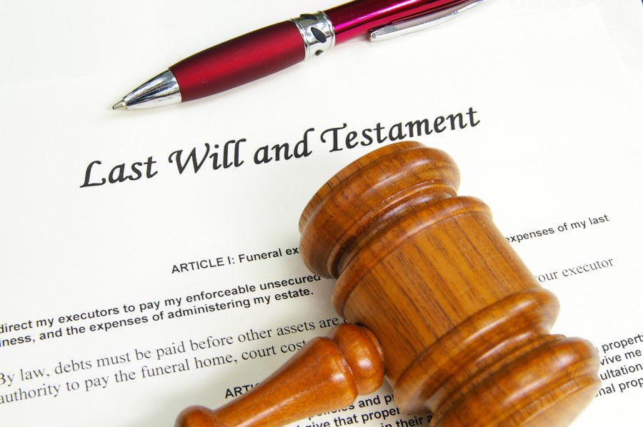 An image of a Last Will and Testament covered by a pen and a gavel